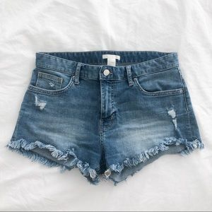 Mid-Rise Denim Shorts with Distressed Bottom